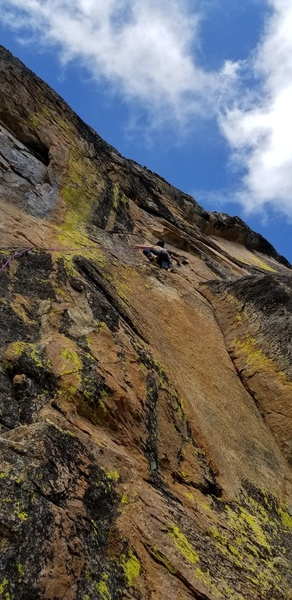 Climber at the end of the ramp and heading up on Twisted Sister