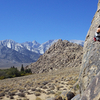 Hannah pulling the Snowball roof.  Lone Pine Peak and Whitney in the far background.  14 Oct 2018.