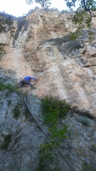 Starting up Foucault's Pendulum (6a+). Note the fixed rope used to access the base of the route.