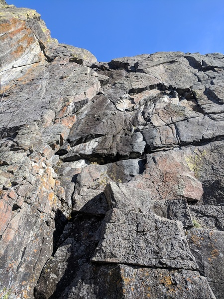 climbs the right facing feature up to the shared anchors on practice crack