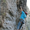 James reaching for the undercling/jug above bolt three.