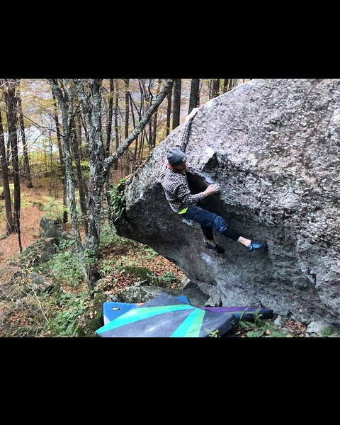 Sticking the move to the lip on the first ascent!
