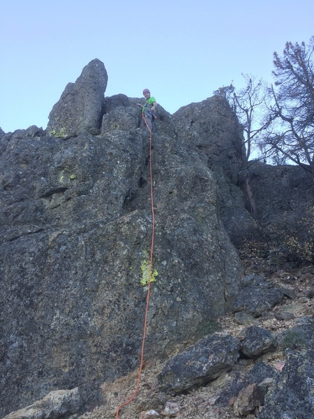 An alcove on a short cliff provides the crux of pitch 2. Photo by Chris Cline.