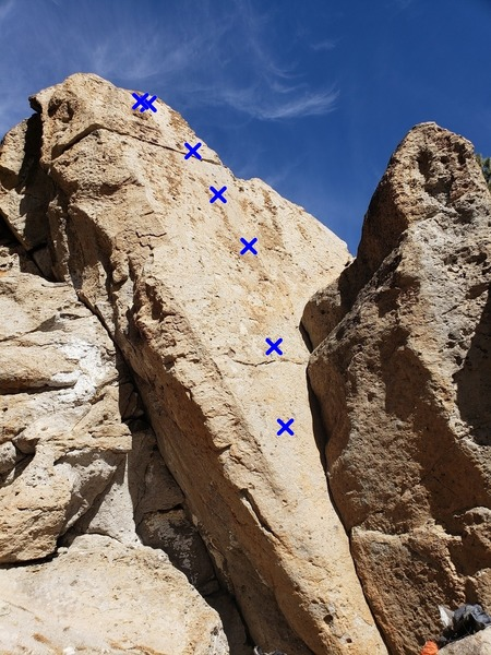 Area 14. X-4 starts in the corner and climbs the right side of the face.