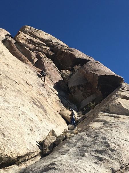 Alex belaying Cameron at base of climb