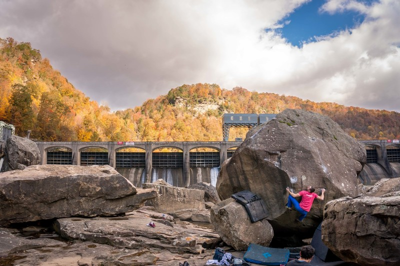 Luke working the difficult first move on a beautiful fall day.<br> <br> Note the large boulder on the left, which fairly recently showed up under the landing for White Eyebrow. Most likely moved after a major flood sometime before winter 2017.