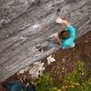 Crux move! Lock off tiny crimp and very high left foot rock on