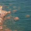 Gigantic rhyolite boulders in Lake Superior at the base of the climbs at Palisade Head.