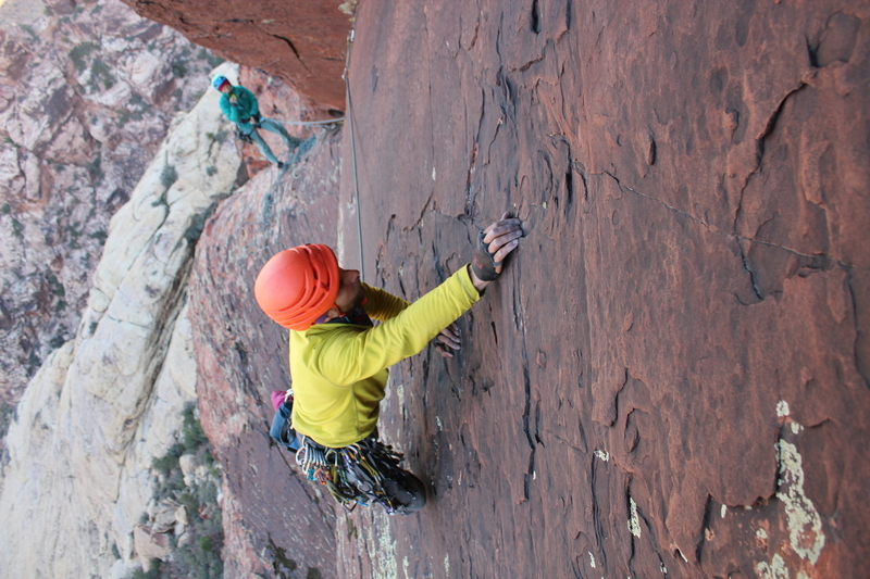 Pulling slab moves on the beautiful varnished rock of pitch 5