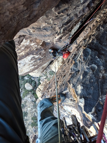 looking down on the p4 belay after escaping the final overhang.