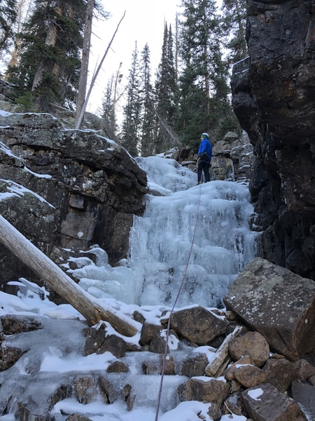 Jason checking out the little bit more ice past the top of the route.