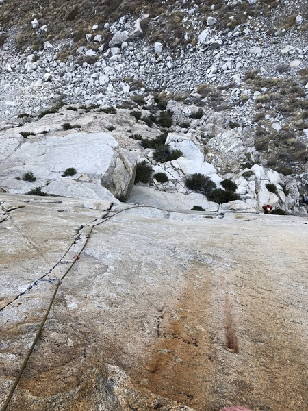 P2: Bottom half is a broken crack followed by a fun traversing roof (5.8). This puts you at the base of the final splitter section (11a).