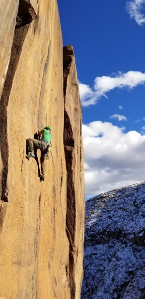 At the point where one leaves the featured foot holds and must commit to the steepening, blank finger crack climbing