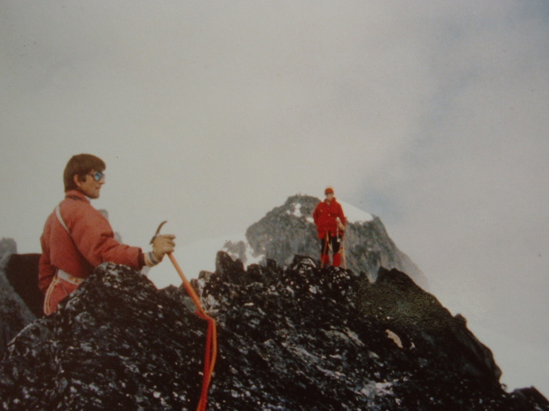 "Roy Preshaw on the summit of Turret; Mt Adamant behind Mary-Jane Cross on the Adamant-Turret-Austerity Traverse    ACC ""Senior Camp"" 1977"