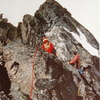 "Mary-Jane Cross and Roy Preshaw on the Adamant-Turret-Auterity traverse. Probably on the E. Ridge of Austerity     ACC ""Senior Camp"" 1977"