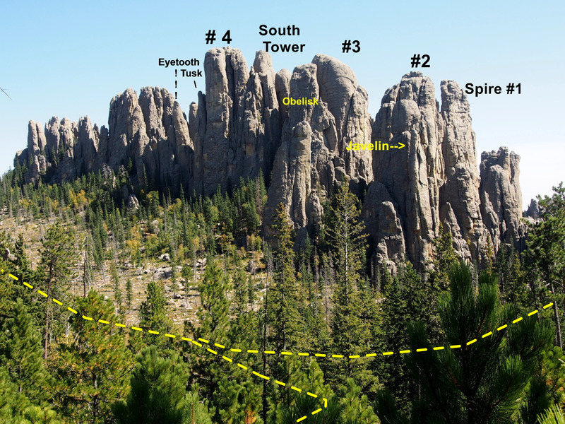 Looking south towards the Spires from the Harney Peak Trail across the valley.  Yellow dashed line is trail from highway, then splitting: Left (in photo, it's a Right on the ground) to Picket Fence.  Trail to Harney Peak is at bottom of photo.