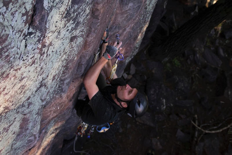 Plugging gear, just past the crux on Congratulations (5.10a)