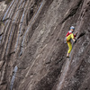 Delap pulling the 2nd crux move on some wet slab