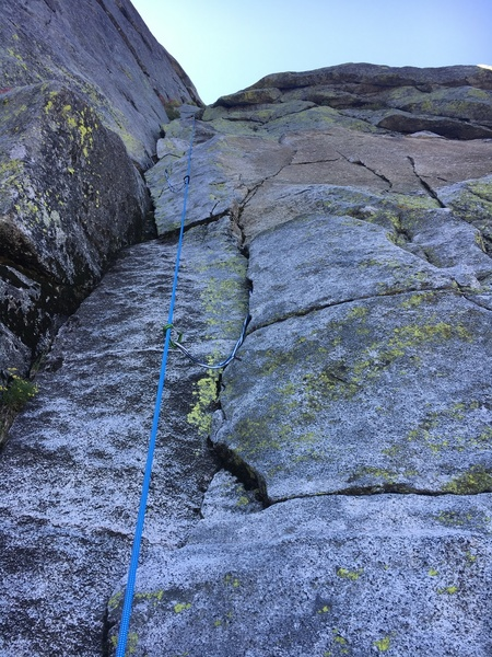 Pitch 2. Some grass and moss in the crack near the top of this pitch you have to deal with.