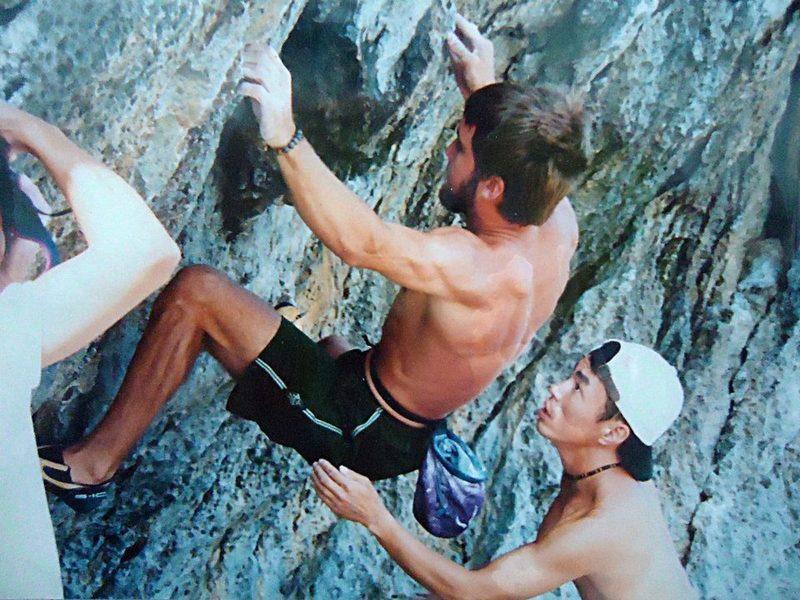 Chris Sharma climbing with Kato Machihiro at Cape Hedo