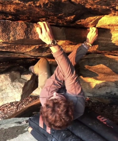 Right hand cross over to pass the crux to a jug