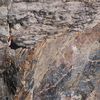 The first ascent pulling through the crux roof. Jer and Jonny.<br> <br> Photo by Nick Rosen.
