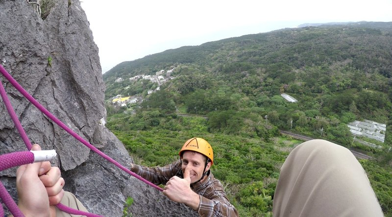 Brent pulling over the Lip of the first Pitch during the First Ascent