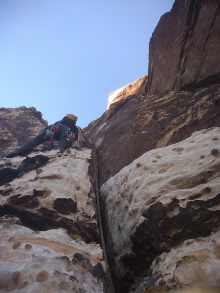 Taking off on pitch 2, after belaying to the left of the chimney on a ledge.