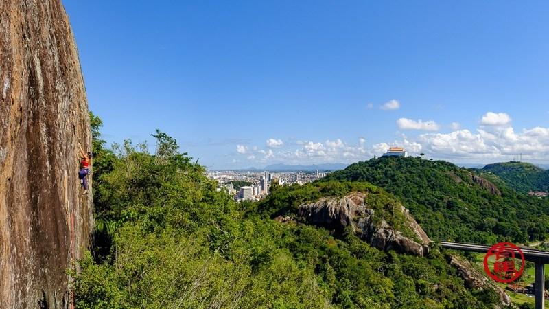 Fernanda climbing with a view. Photo: Naoki Arima