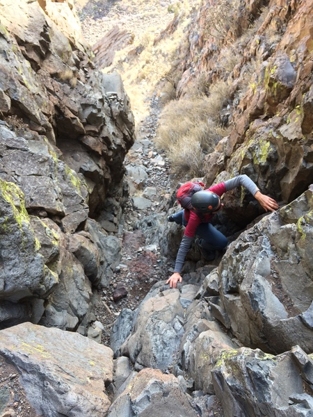 Teresa, making her way through the lower gully section. Helmets are a very good idea... lots of loose rock.