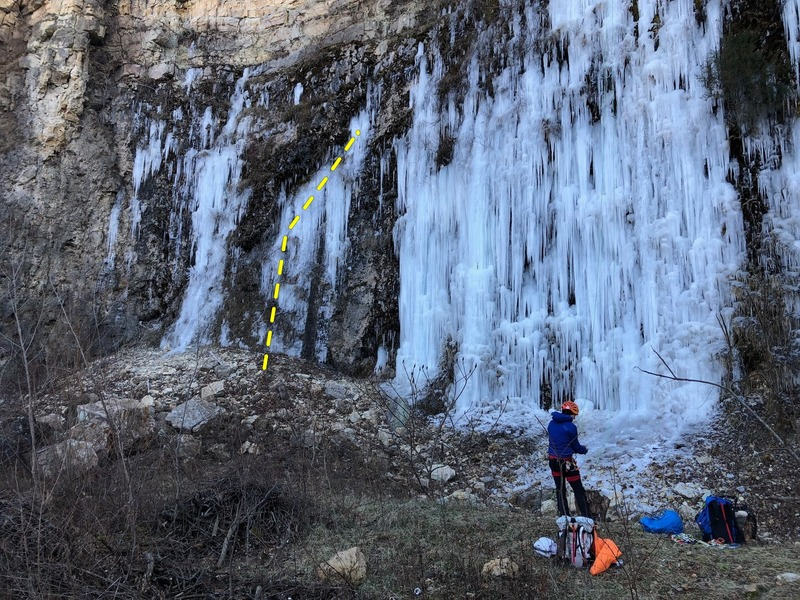 Cooing Pigeons is the second climb from the left.  Junkyard Dog is the WIDE ice behind the climber in this photo.  Taken Dec. 2018 on a super wet summer & Fall. Rap off a V thread at the highest, best piece of ice to do so.