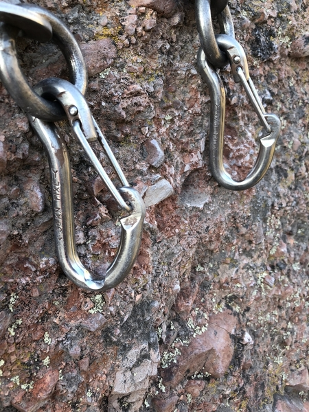 These are the current lower-off clip in anchors on top of Subterranean Tango. Note the grooves left in the biners from people top-roping off them. If you are going to top-rope, please do everyone a favor and use your own gear for the toprope.