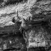 Nate executing the main crux. His left hand is on the sloppy popcorn hold that really gives this route the 12a grade