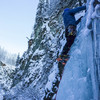 Bryan Hesse placing an ice screw on the first pitch of Ripple
