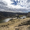 View downstream (to west) of Pillar Falls and Snake River from crag. Photo by Sean Muldoon. https://www.foreverwild.media/