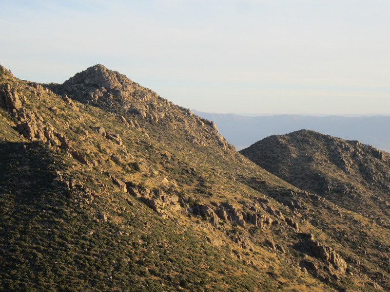 Some of the typical craggyness of the range with the Hualapai Valley and the edge of the Grand Canyon in the back.