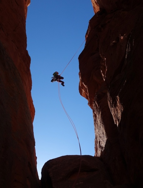 Rappelling into the notch. Two rappels with a single 60.