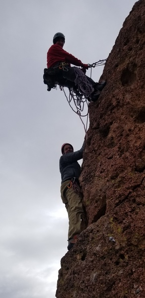 Clint Mortenson Belaying his partner up Jugorknot on Greevers' Needle