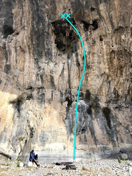 The route ascends the slab to a detached tufa / stalactite and then into a large hueco.