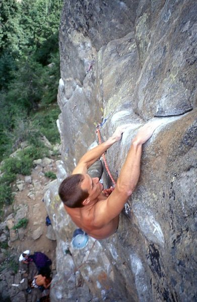 Chris Alber on the crux slopers of Nevermore, around 1996.<br> <br> Photo:  Mark Rolofson.