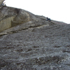Mike climbing the splitter headwall pitch on the F.A. of Sharp Shooter