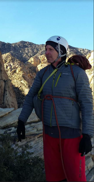 Tony Yinger getting ready to get off the summit of Whiskey Peak
