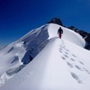 Striding toward the summit block of Parcocaya after climbing the south face,
