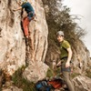 Andreas starting up the route and Josh on belay.