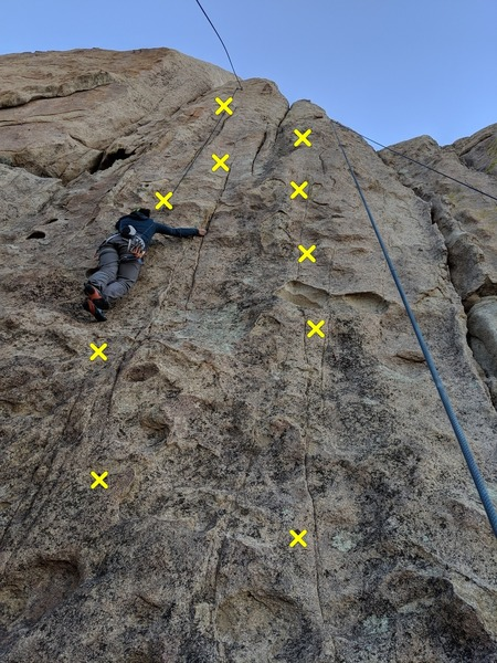 Climber is on Under Pressure (5.9) Unknown 5.9 is on the right.