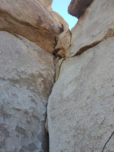 (Top) Upper section of the crack. I'm assuming the route would end at the ledge. (No cracks up Frock proper, unless traversing right into Commitment Time is possible?