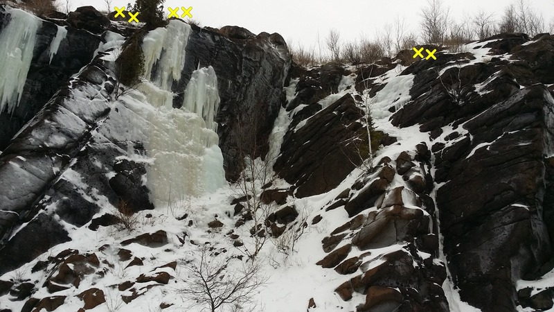 Gully in the center is WI2/3, M2/3. Head back about 30 ft at the top for trees. Ice on the left starts with slightly slabby WI3 and finishes on an acrobatic WI4/5 section. Rap anchors 20 ft back. Thin line on the right is also about WI2/3, M2/3.