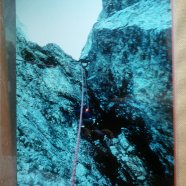 this is a photo dated 1986 ; it is the beginning of the route of via Della Rampa to Piz Ciavazez (Mount Sella Group in Dolomite) ; I am in the photo with red helmet and my mountain guide is up (he is a young Hans Peter Eisendle)
