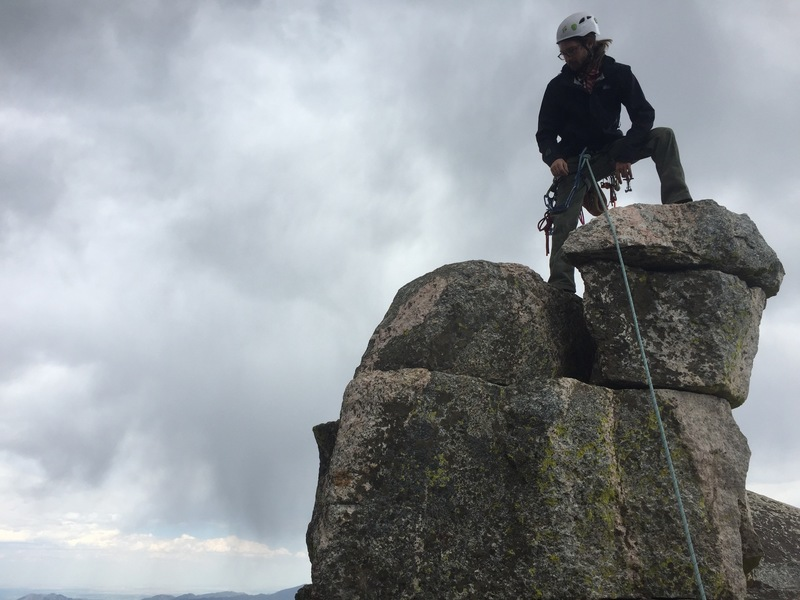 On the tippy top of the summit. The large flat ledge below is big enough to have a lay down.