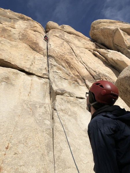 J man taking a lap, with Brian on belay